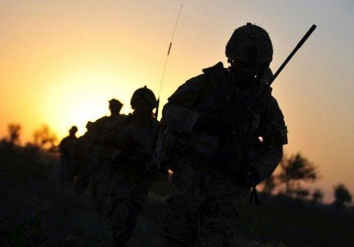 "British soldiers patrol the Nahr-e-Saraj dstrict of Helmand province in June 2010. An Afghan police officer has killed three British soldiers serving with NATO in Afghanistan's troubled south, the latest in a series of escalating ""green on blue"" attacks in the decade-long war"