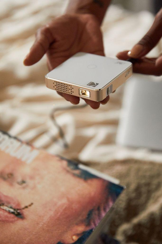 """<h2>Kodak Luma 75 Pocket Projector</h2><br>Transform your bedroom or rooftop hang into a movie theatre with this tiny, yet efficient, projector from Kodak. <br><br><em>Shop <strong><a href=""""https://fave.co/2JY0Hup"""" rel=""""nofollow noopener"""" target=""""_blank"""" data-ylk=""""slk:Urban Outfitters"""" class=""""link rapid-noclick-resp"""">Urban Outfitters</a></strong></em><br><br><strong>Kodak</strong> Kodak Luma 75 Pocket Projector, $, available at <a href=""""https://go.skimresources.com/?id=30283X879131&url=https%3A%2F%2Ffave.co%2F2Ir0Eqv"""" rel=""""nofollow noopener"""" target=""""_blank"""" data-ylk=""""slk:Urban Outfitters"""" class=""""link rapid-noclick-resp"""">Urban Outfitters</a>"""