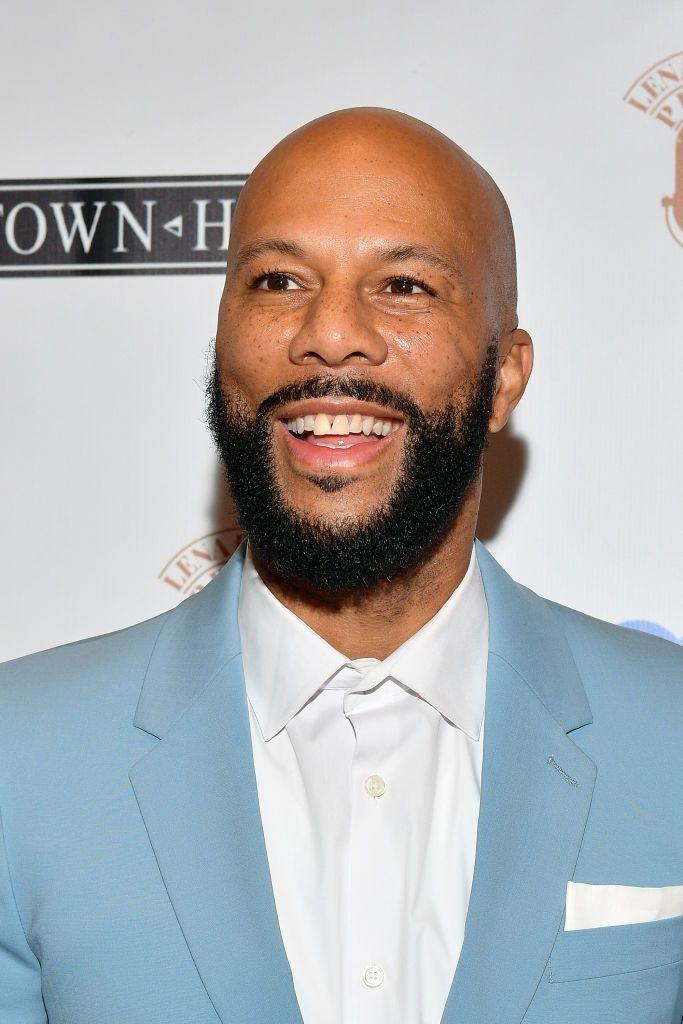 <p><strong>As seen on Common</strong></p><p>You might assume that the best way to soften the look of a fully-bald head is to make your beard super angular. However, as shown here on Common, the opposite could be true. When there's not hair on top to add height, a full beard cut in an oval can help to elongate your face and make it look taller and slimmer. It works best on thick beards, which can really show off the shape, and—heads up, it requires regular trimming.</p>
