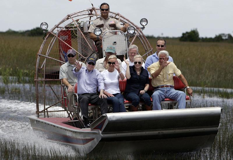 (L-R-front) Republican presidential candidate John McCain, wife Cindy McCain, daughter Meghan McCain, Florida Gov. Charlie Crist and Rep. Mario Diaz-Balart (R-back) ,R-FL, ride on an airboat as they tour the Everglades Safari Park June 6, 2008 in Miami, Florida. The Everglades is the largest wetlands in North America. AFP PHOTO/POOL/Charles Trainor, Jr. (Photo credit should read Charles Trainor, Jr./AFP/Getty Images)