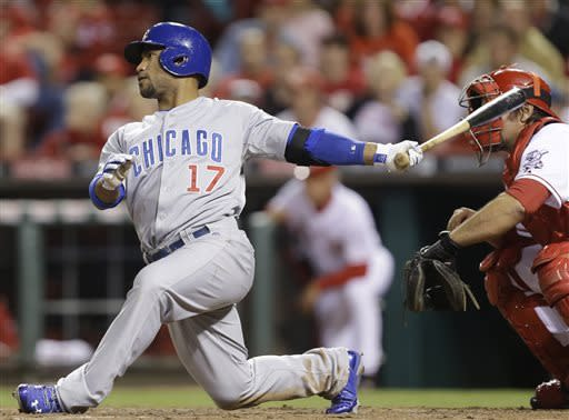 Chicago Cubs' Dave Sappelt (17) hits a single to drive in a run off Cincinnati Reds relief pitcher Manny Parra in the 10th inning of a baseball game, Tuesday, April 23, 2013, in Cincinnati. Chicago won 4-2 in 10 innings. Corky Miller catches at right. (AP Photo/Al Behrman)