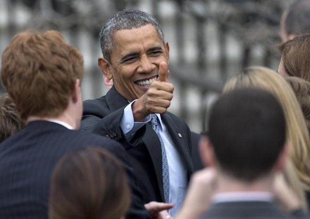 President Barack Obama give the thumbs up as he greets people during a ceremony on the South Lawn of the White House in Washington, Tuesday, April 1, 2014, to honor the 2013 World Series baseball champion Boston Red Sox. (AP Photo/Carolyn Kaster)