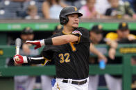 Pittsburgh Pirates' Yoshi Tsutsugo strikes out against Cincinnati Reds starting pitcher Tyler Mahle during the first inning of a baseball game against the Cincinnati Reds in Pittsburgh, Thursday, Sept. 16, 2021. The Reds won 1-0. (AP Photo/Gene J. Puskar)