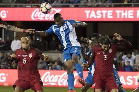 March 24, 2017; San Jose, CA, USA; Honduras defender Ever Alvarado (5) heads the ball against United States defender John Brooks (6) and defender Omar Gonzalez (3) during the first half of the Men's World Cup Soccer Qualifier at Avaya Stadium. Mandatory Credit: Kyle Terada-USA TODAY Sports