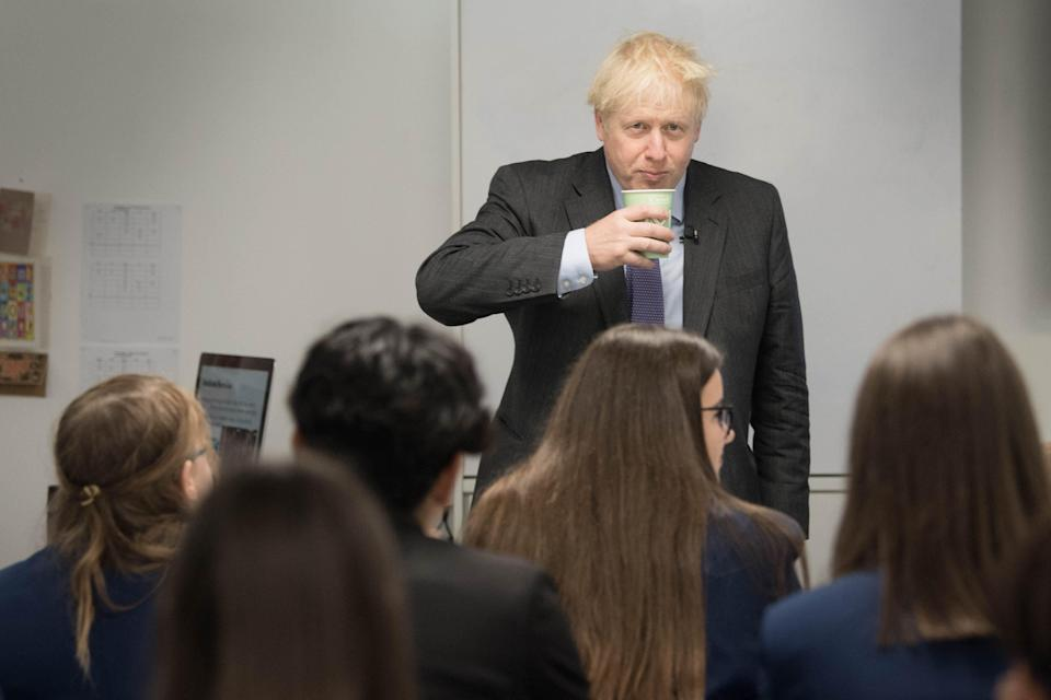 Prime Minister Boris Johnson meets pupils and takes part in a  media studies class during a visit to Ruislip High School in his constituency of Uxbridge, west London in September (Stefan Rousseau/PA Wire)