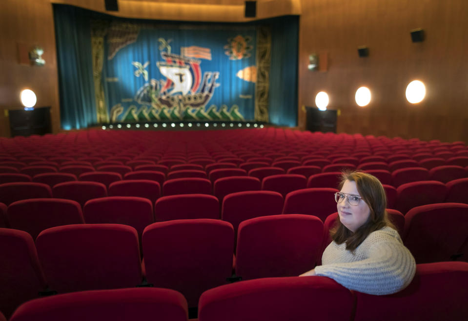 Malin Hellberg, sits alone to watch the film Tigrar, in Gothenburg, Sweden on Saturday, Jan. 30, 2021. The 44th Goteborg film festival opened this weekend in a mostly virtual format. For the real world movie experience, a lottery determines who gets the one ticket for the 700-seat cinema. (AP Photo/Thomas Johansson)