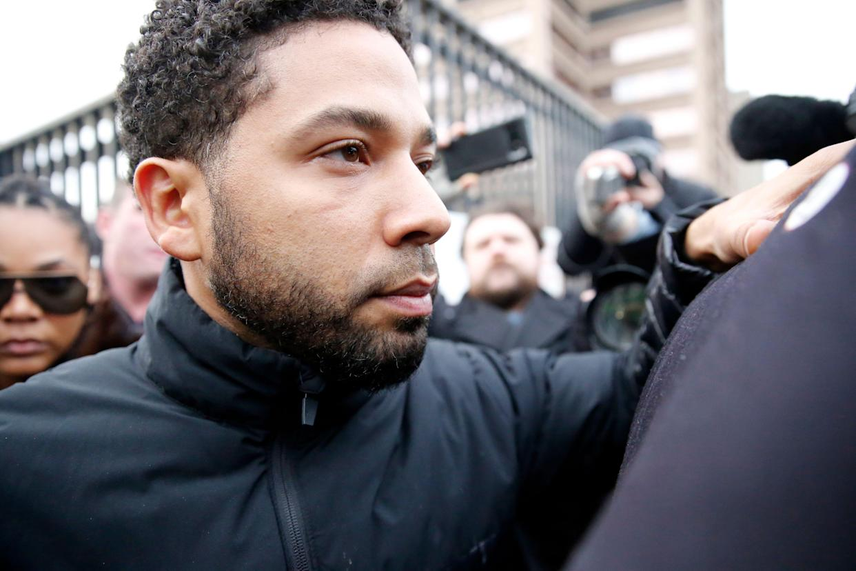 Jussie Smollett leaves Cook County jail after posting bail on Feb. 21. A judge set his bond $100,000 required the actor to surrender his passport.