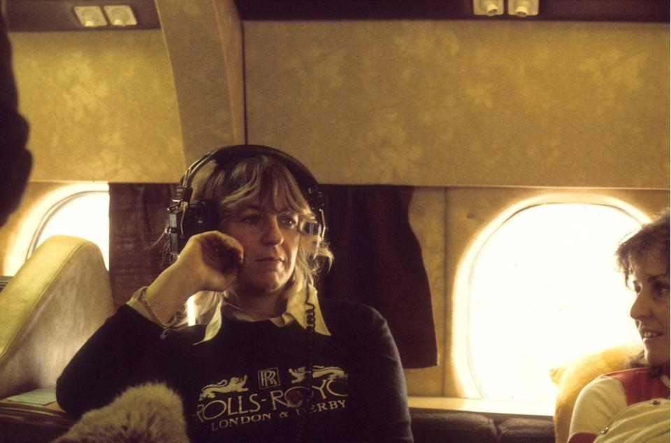 <p>Christine McVie of Fleetwood Mac sits on their private jet in 1975. </p>