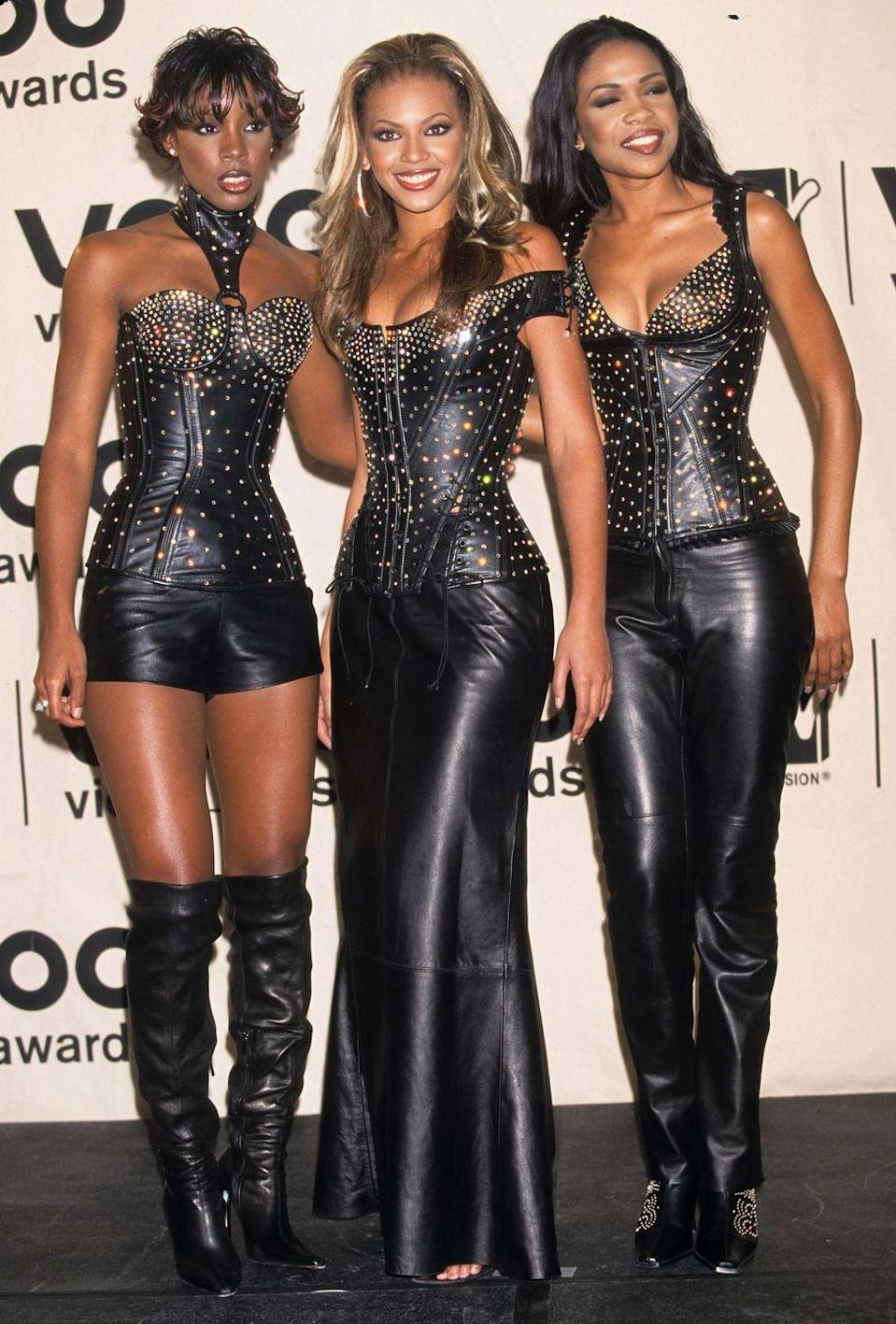 <p>The three-person group matched in leather rhinestone bodices and coordinating bottoms at the 2000 VMAs red carpet.</p>