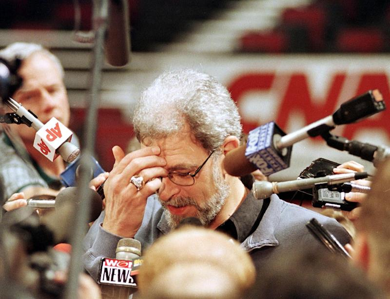 CHICAGO, UNITED STATES: Chicago Bulls head coach Phil Jackson (C) is surrounded by reporters as he answers questions about Bulls player Dennis Rodman after their practice 09 June at the United Center in Chicago, IL. Rodman missed practice 08 June to appear on a World Championship Wrestling broadcast from Detroit, MI. Rodman was fined USD 10,000 by the NBA for his actions. The Bulls beat the Utah Jazz 96-54 in game three of the NBA Finals 07 June to take a 2-1 lead in the best-of-seven series. AFP PHOTO Robert SULLIVAN (Photo credit should read ROBERT SULLIVAN/AFP via Getty Images)