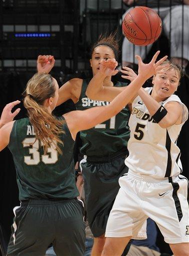Purdue's Brittany Rayburn (5) pulls a rebound away from Michigan State's Taylor Alton (33) during the first half of an NCAA college basketball game at the women's Big 10 tournament, Friday, March 2, 2012, in Indianapolis. (AP Photo/The Indianapolis Star, Matt Kryger) NO SALES