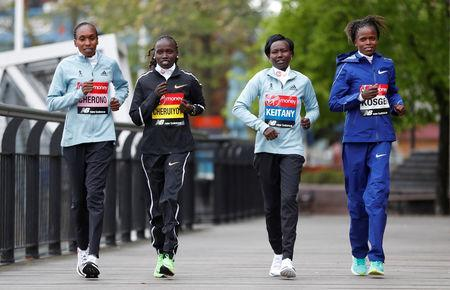 Athletics - London Marathon Preview Press Conference - The Tower Hotel, London, Britain - April 25, 2019 Kenya's Gladys Cherono, Vivian Cheruiyot, Mary Keitany and Brigid Kosgei pose ahead of the London marathon Action Images via Reuters/Matthew Childs