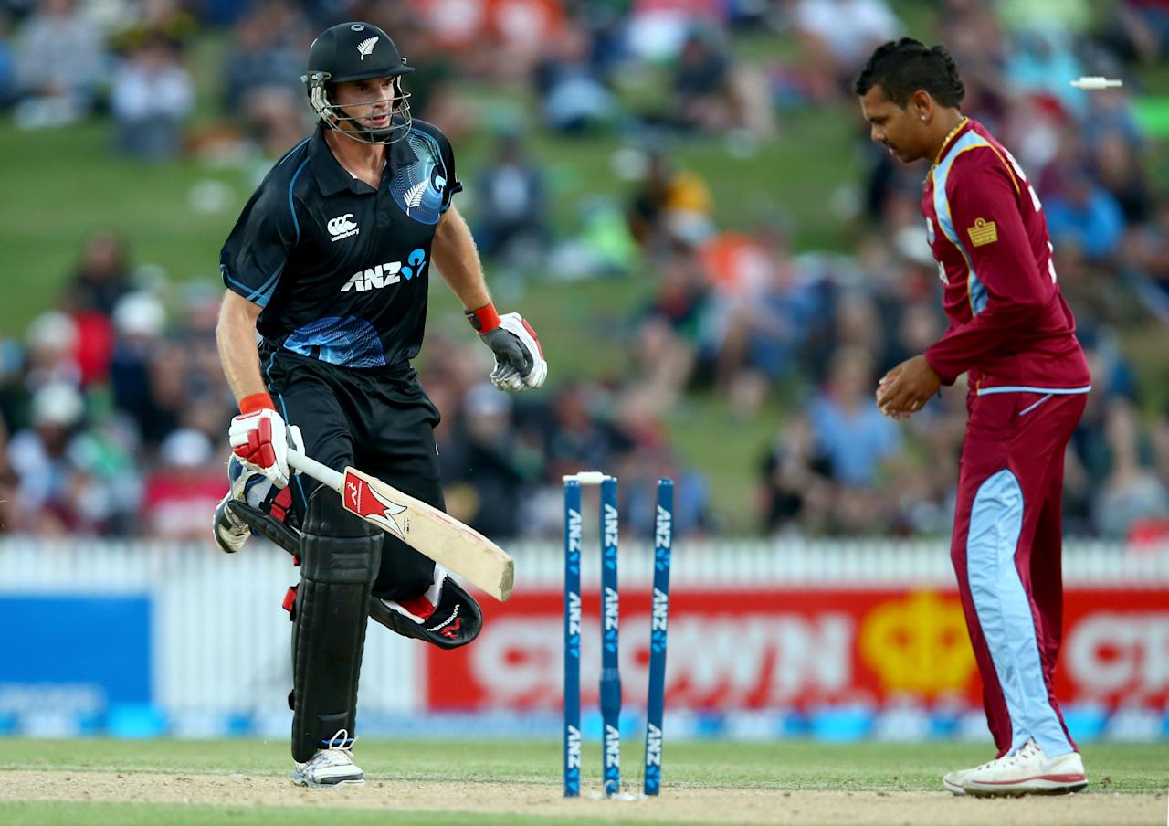 HAMILTON, NEW ZEALAND - JANUARY 08: Kyle Mills of New Zealand is run out during game five of the One Day International Series between New Zealand and the West Indies at Seddon Park on January 8, 2014 in Hamilton, New Zealand.  (Photo by Phil Walter/Getty Images)