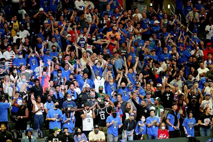 Clippers fans celebrate the team's 131-119 comeback victory over the Utah Jazz at Staples Center on Friday.