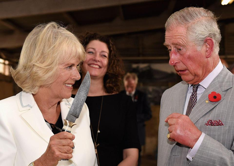"""<p>This picture proves that you don't want to mess with Camilla. <a href=""""https://www.goodhousekeeping.com/life/a22560670/camilla-parker-bowles-cast-finger-injury-sandringham-flower-show/"""" rel=""""nofollow noopener"""" target=""""_blank"""" data-ylk=""""slk:The Duchess of Cornwall"""" class=""""link rapid-noclick-resp"""">The Duchess of Cornwall</a> was <em>clearly</em> joking around with her husband while holding a knife during a relaxing winery tour in Australia. Charles, playing along, looked stunned and terrified ... and also maybe learned that he shouldn't try to steal a sip of the Duchess's wine <em>ever</em> again.</p>"""