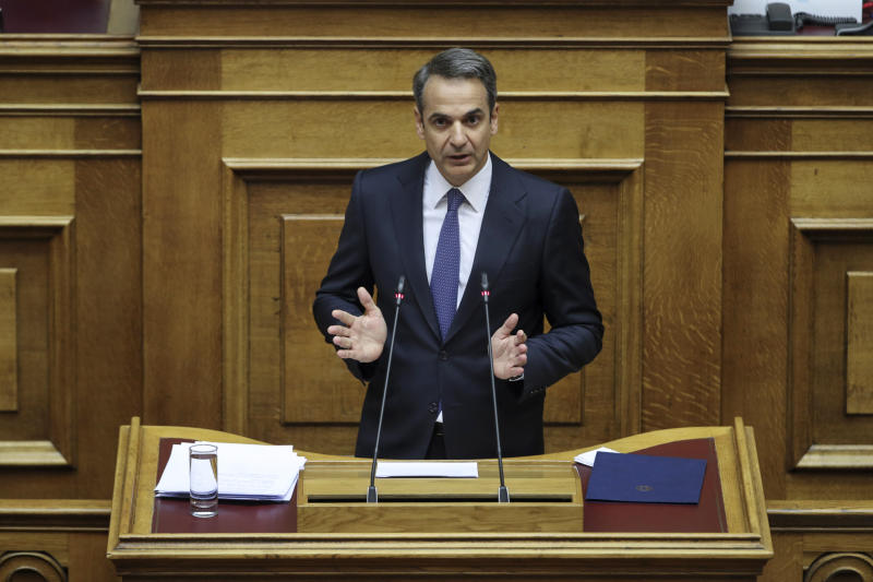 Greece's Prime Minister Kyriakos Mitsotakis addresses lawmakers during a parliamentary session to present his government's policies in Athens, Saturday, July 20, 2019.(AP Photo/Petros Giannakouris)