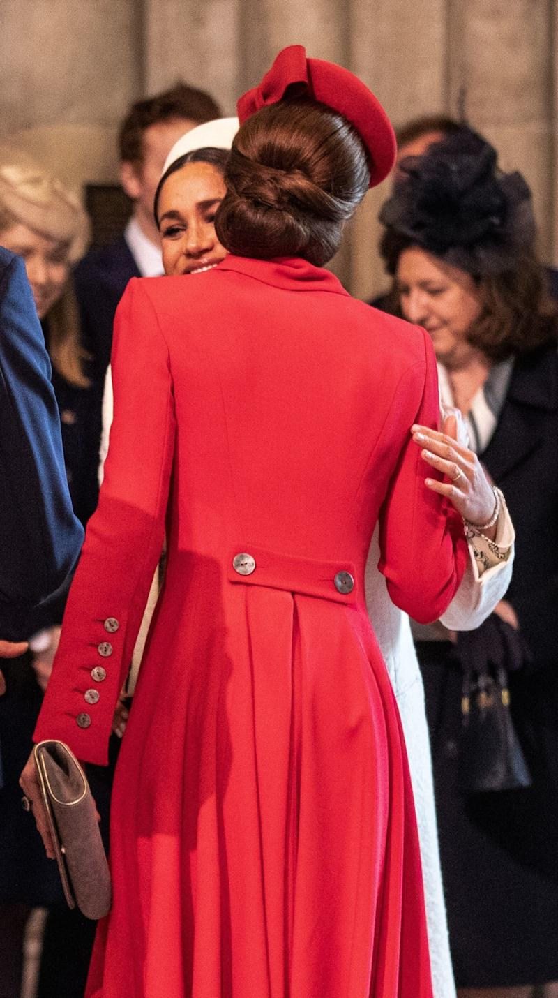 The two women embracing.  (RICHARD POHLE via Getty Images)