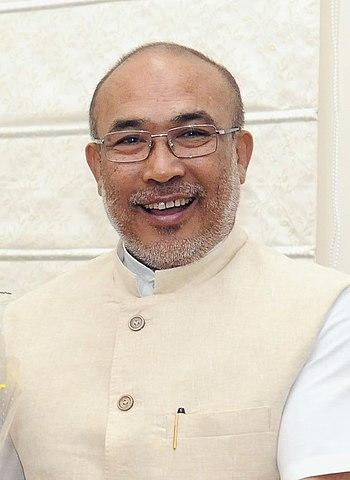 The former footballer and journalist, who was the Minister of Irrigation & Flood Control and Youth Affairs & Sports under the Congress government, quit the Manipur Legislative Assembly and the Manipur Pradesh Congress Committee in 2015, in protest against the then CM Okram Ibobo Singh, with whom his relationship soured after he was excluded from the cabinet. Singh joined BJP on October 17, 2016, and became the Spokesperson and Co-convener of the Election Management Committee of BJP Manipur Pradesh. In March 2017, Singh was elected as the leader of the BJP Legislative Party in Manipur. He went on to head the state's first BJP-led government after he won a floor test in the assembly by voice vote. <em><strong>Image credit:</strong></em> By Vice President's Secretariat (GODL-India), GODL-India, https://commons.wikimedia.org/w/index.php?curid=81024227