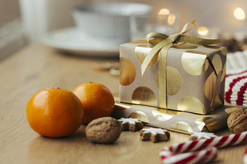 Christmas presents, tangerines, walnuts, candy canes and cinnamon stars