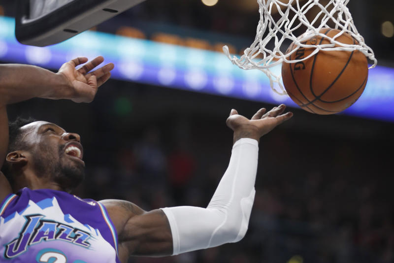 Utah Jazz forward Jeff Green watch his dunk during the first half of the team's NBA basketball game against the Memphis Grizzlies, Saturday, Dec. 7, 2019, in Salt Lake City. (AP Photo/George Frey)