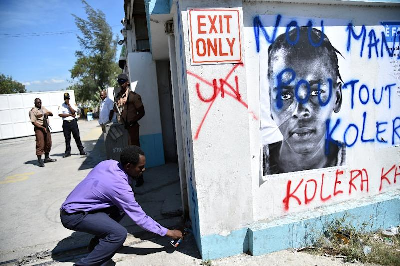 Haitian activists and victims of cholera rally in front of the UN Stabilization Mission in Haiti in Port-au-Prince, on October 15, 2015 (AFP Photo/Hector Retamal)