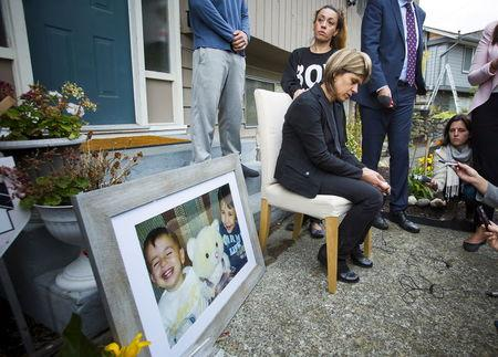 Tima Kurd cries while speaking to the news media outside her home in Coquitlam, B.C.