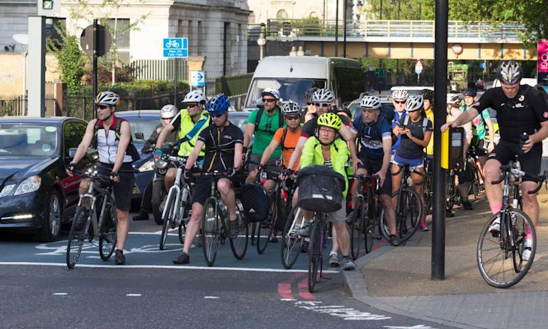Commuters cycling home during rush hour in London.