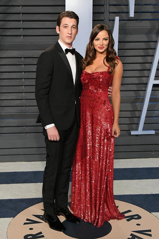 <p>Newly engaged Miles Teller and Keleigh Sperry made a handsome pair at <em>Vanity Fair</em>. (Photo: Jon Kopaloff/WireImage) </p>
