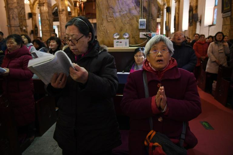 China's roughly 12 million Catholics are divided between a government-run association and an unofficial underground church loyal to the Vatican