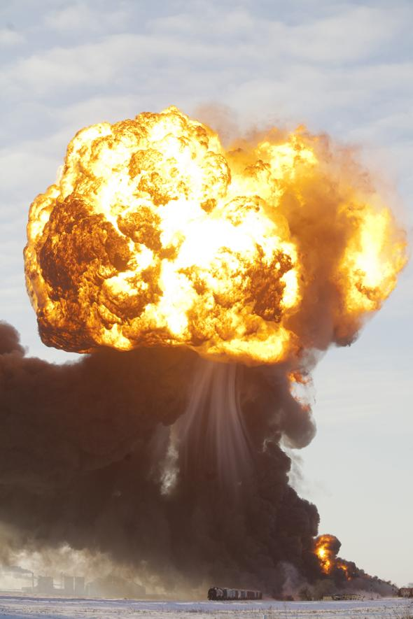Mandatory Credit: Photo by ZUMA/REX (3452782a) A massive fireball from an exploding train car rises into the air just west of Casselton. Train collision ignites an oil tankers in North Dakota, America - 30 Dec 2013 The freight train was carrying 110 cars and went off the tracks west of Casselton and was hit by a second train. There were no reports of injuries from the accident.