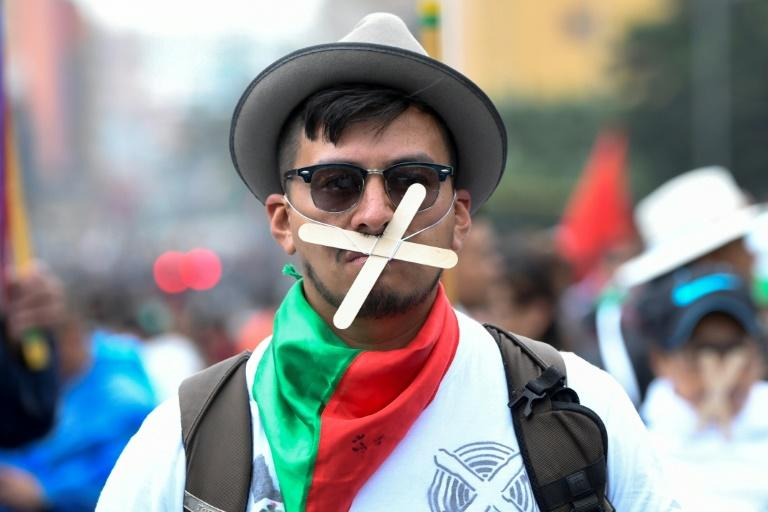 A protester taking part in a general strike against the policies of President Ivan Duque's right-wing government in Bogota (AFP Photo/JUAN BARRETO)