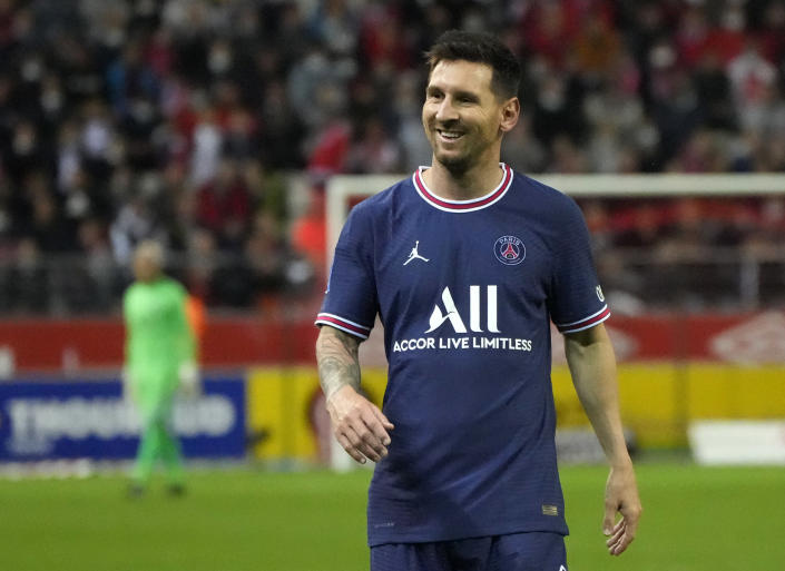PSG's Lionel Messi smiles during the France League One soccer match between Reims and Paris Saint-Germain, at the Stade Auguste-Delaune in Reims, France, Sunday, Aug. 29, 2021. (AP Photo/Francois Mori)