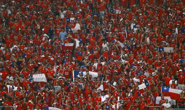 Chile fans wait for the 2014 World Cup Group B soccer match between Spain and Chile at the Maracana stadium