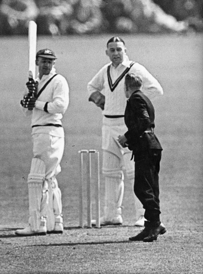 Australian cricketer Don Bradman (1908 - 2001) receiving a telegram on the pitch during a match between Australia and Worcester.  Original Publication: People Disc - HW0393   (Photo by Fox Photos/Getty Images)