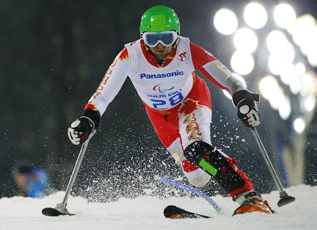 Matt Hallat of Canada competes during the men's alpine skiing, slalom, standing event at the 2014 Winter Paralympic, Thursday, March 13, 2014, in Krasnaya Polyana, Russia. (AP Photo/Dmitry Lovetsky)