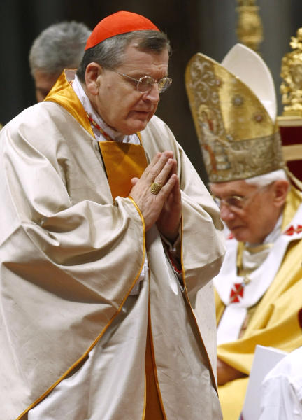 FILE - In this Sunday, Nov. 21, 2010 file photo, newly-appointed U.S. Cardinal Raymond Leo Burke walks past Pope Benedict XVI after receiving Cardinal's ring during a mass in St. Peter's Basilica, at the Vatican. Burke, the former St. Louis archbishop, is the first American to lead the Vatican supreme court. (AP Photo/Pier Paolo Cito)