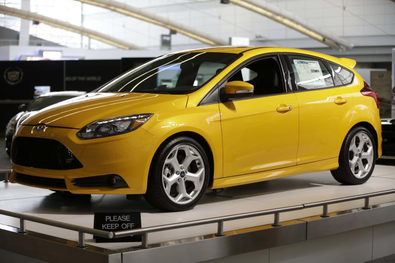 FILE - This file photo taken Feb. 14, 2013 shows the 2013 Ford Focus ST on display at the 2013 Pittsburgh Auto Show in Pittsburgh. Ford on Wednesday, Oct. 23, 2013 claimed the top-selling car in the world crown for its Focus compact during the first half of the year, based on registration data gathered by the R.L. Polk & Co. research firm. (AP Photo/Gene J. Puskar, File)