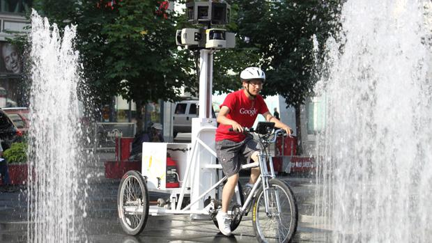 Jonathan Chang, 27, rides the Google Street View trike around Yonge-Dundas Square in Toronto.