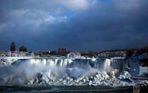 <p>Water flows over the American Falls as ice forms in this view from the Canadian side in Niagara Falls, Ont., Tuesday, Jan. 2, 2018. Almost every year frigid temperatures transform the falls into an icy winter wonderland when the mist is blown back, freezing on the landscape. (Aaron Lynett/The Canadian Press via AP) </p>
