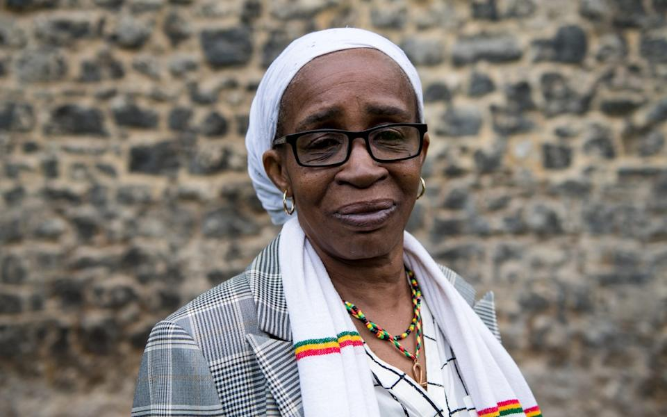 LONDON, ENGLAND - MAY 01: Paulette Wilson, 62, (moved to Britain in 1968 from Jamaica) poses for a photograph on College Green after members of the Windrush generation and their families attend a meeting with MPs at the House of Commons on May 1, 2018 in London, England. Residents from the Caribbean and African Commonwealth countries first arrived on the HMT Empire Windrush from June 1948 until the 1970s. Recently many from the Windrush Generation have been asked to leave the UK or denied healthcare as they have no official documentation. The British Home Secretary, Amber Rudd, resigned over the matter when it transpired she had 'inadvertently misled' parliament on the Home Office's policy on enforced returns. (Photo by Chris J Ratcliffe/Getty Images) - Chris J Ratcliffe/Getty Images