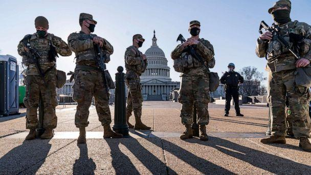 PHOTO: Members of the Michigan National Guard and the U.S. Capitol Police keep watch as heightened security remains in effect around the Capitol, in Washington, D.C., March 3, 2021. (J. Scott Applewhite/AP)