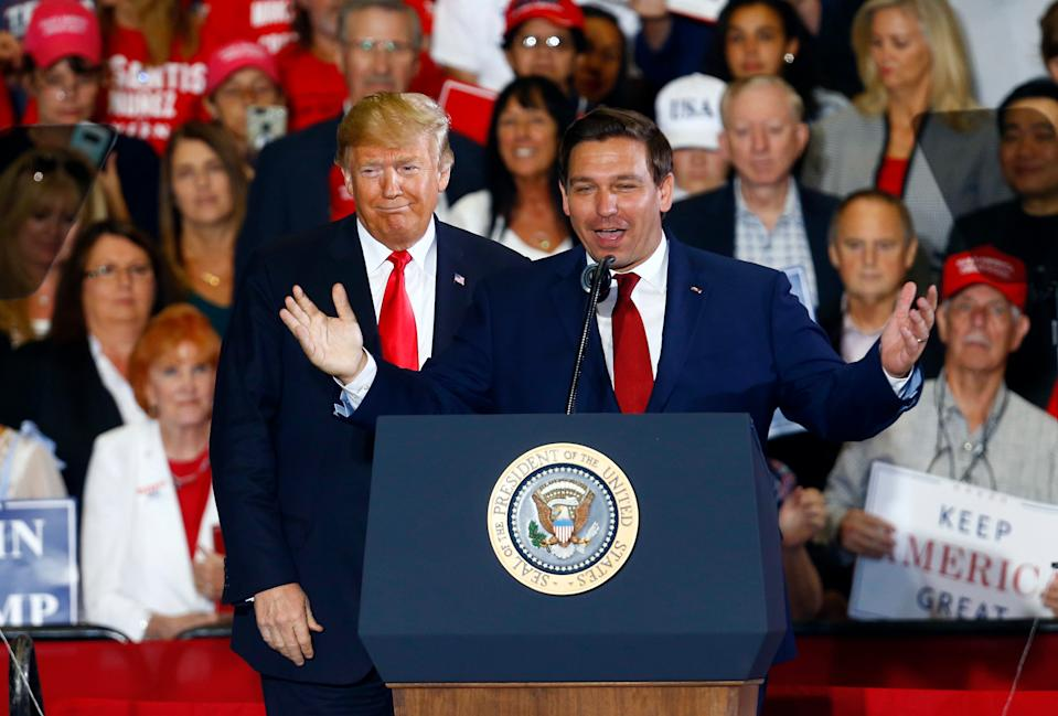 President Donald Trump stands behind Ron DeSantis, Candidate for Governor of Florida, as he speaks at a rally, Saturday, Nov. 3, 2018, in Pensacola, Fla.