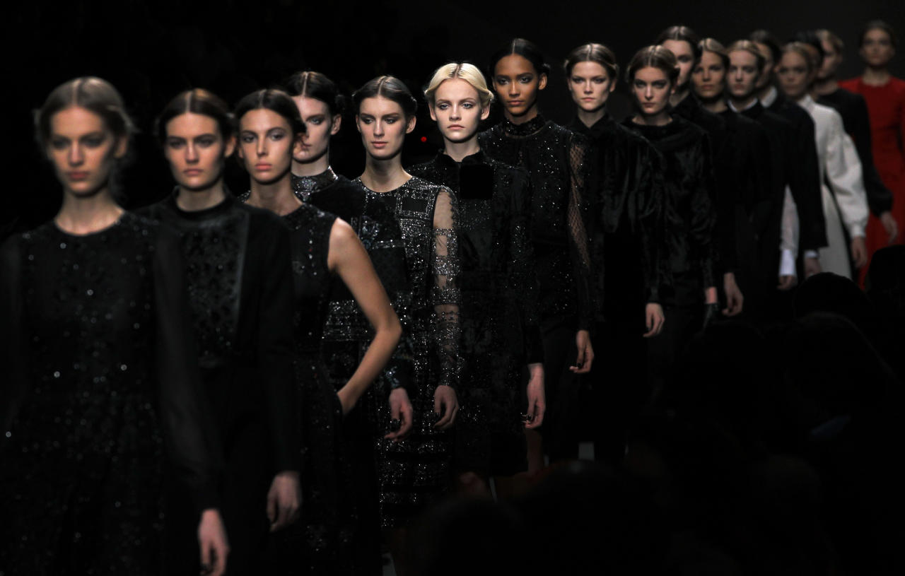 Models wear creations by Maria Grazia Chiuri and Pier Paolo Piccioli for Valentino as part of the Fall-Winter, ready-to-wear 2013 fashion collection, during Paris Fashion week, Tuesday, March 6, 2012. (AP Photo/Christophe Ena)