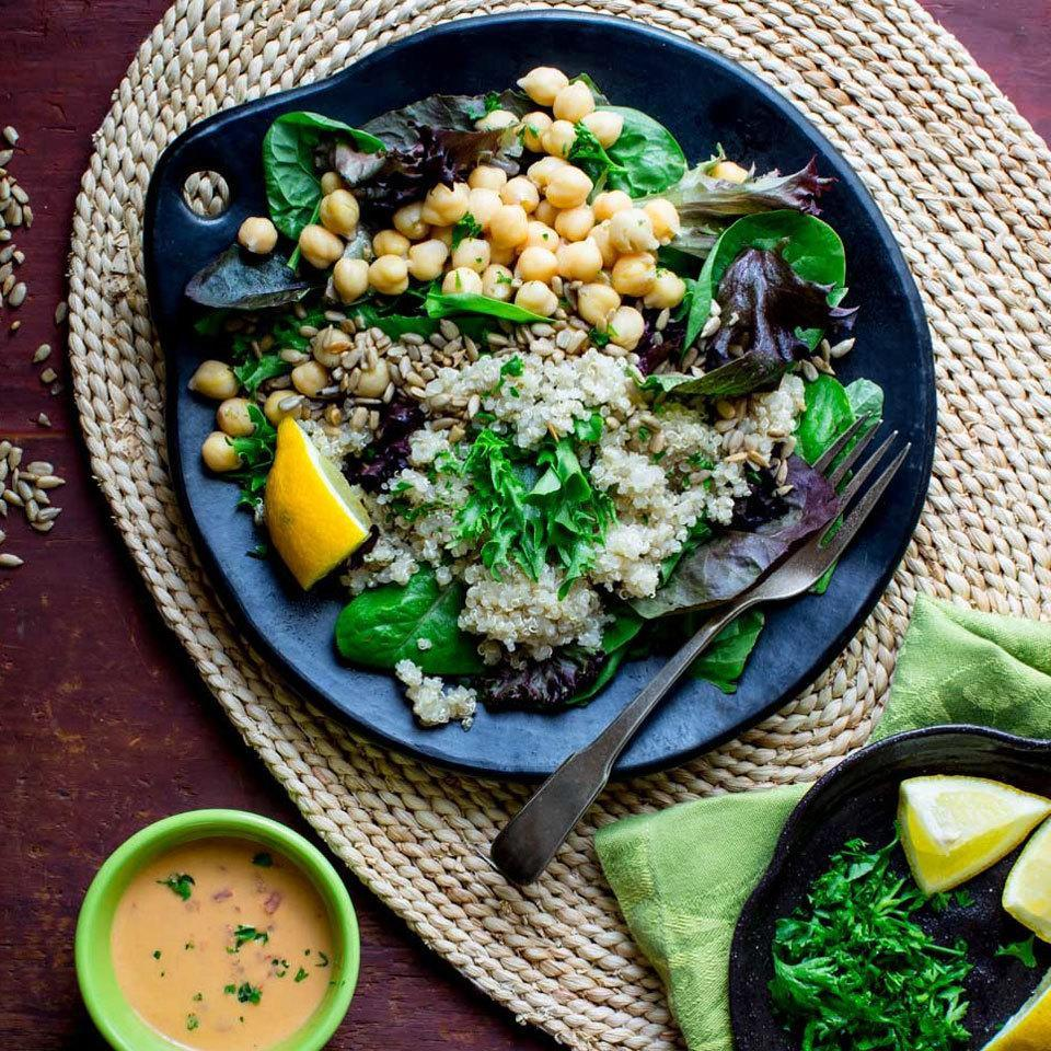 """<p>This hearty vegan salad is loaded with plant-based power ingredients: chickpeas, quinoa and hummus. We love the crunch of the sunflower seeds and the unexpected flavor of roasted peppers. <a href=""""http://www.eatingwell.com/recipe/259996/quinoa-chickpea-salad-with-roasted-red-pepper-hummus-dressing/"""" rel=""""nofollow noopener"""" target=""""_blank"""" data-ylk=""""slk:View recipe"""" class=""""link rapid-noclick-resp""""> View recipe </a></p>"""