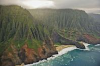 """<p>With a nickname like """"The Garden Isle,"""" this Hawaiian island must live up to the hype. The most remote of the archipelago's most popular islands, Kauai boasts lush, green mountains, dramatic rock formations, golden sands, and fantastic waters for surfing and swimming.</p><p>Enjoy Kauai at its finest with a stay at <a href=""""https://www.lodgeatkukuiula.com/"""" rel=""""nofollow noopener"""" target=""""_blank"""" data-ylk=""""slk:The Lodge at Kukui'ula"""" class=""""link rapid-noclick-resp"""">The Lodge at Kukui'ula</a> on the island's southern shore, which offers elegant, residential-style stays and one-of-a-kind experiences and amenities.</p>"""