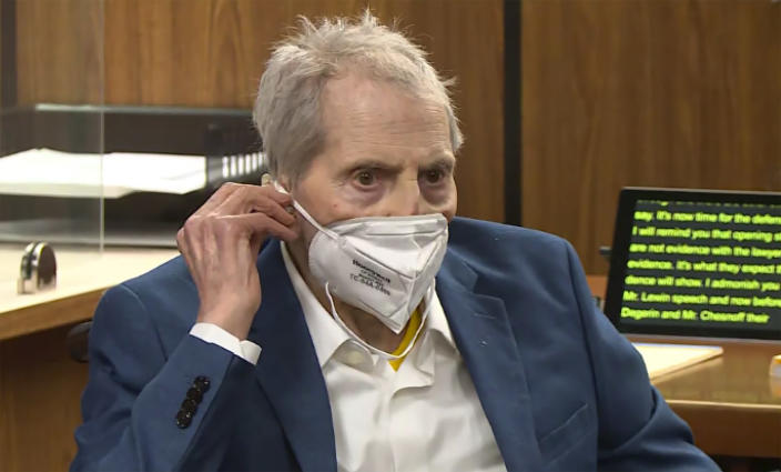 FILE - In this still image taken from the Law&Crime Network court video, real estate heir Robert Durst watches as his defense attorney Dick DeGuerin presents a new round of opening statements in the murder case against Durst after a 14-month recess due to the coronavirus pandemic in Los Angeles County Superior Court in Inglewood, Calif., on Wednesday, May 19, 2021. Durst, 78, an heir to a New York commercial real estate empire, is charged with first-degree murder in the slaying of his best friend, Susan Berman. A judge on Monday, June 14 has ordered that the trial of Durst will continue, despite defense requests for a delay because he's in too much pain. Durst was hospitalized and the trial was put on pause Thursday, June 10. (Law&Crime Network via AP, Pool, File)