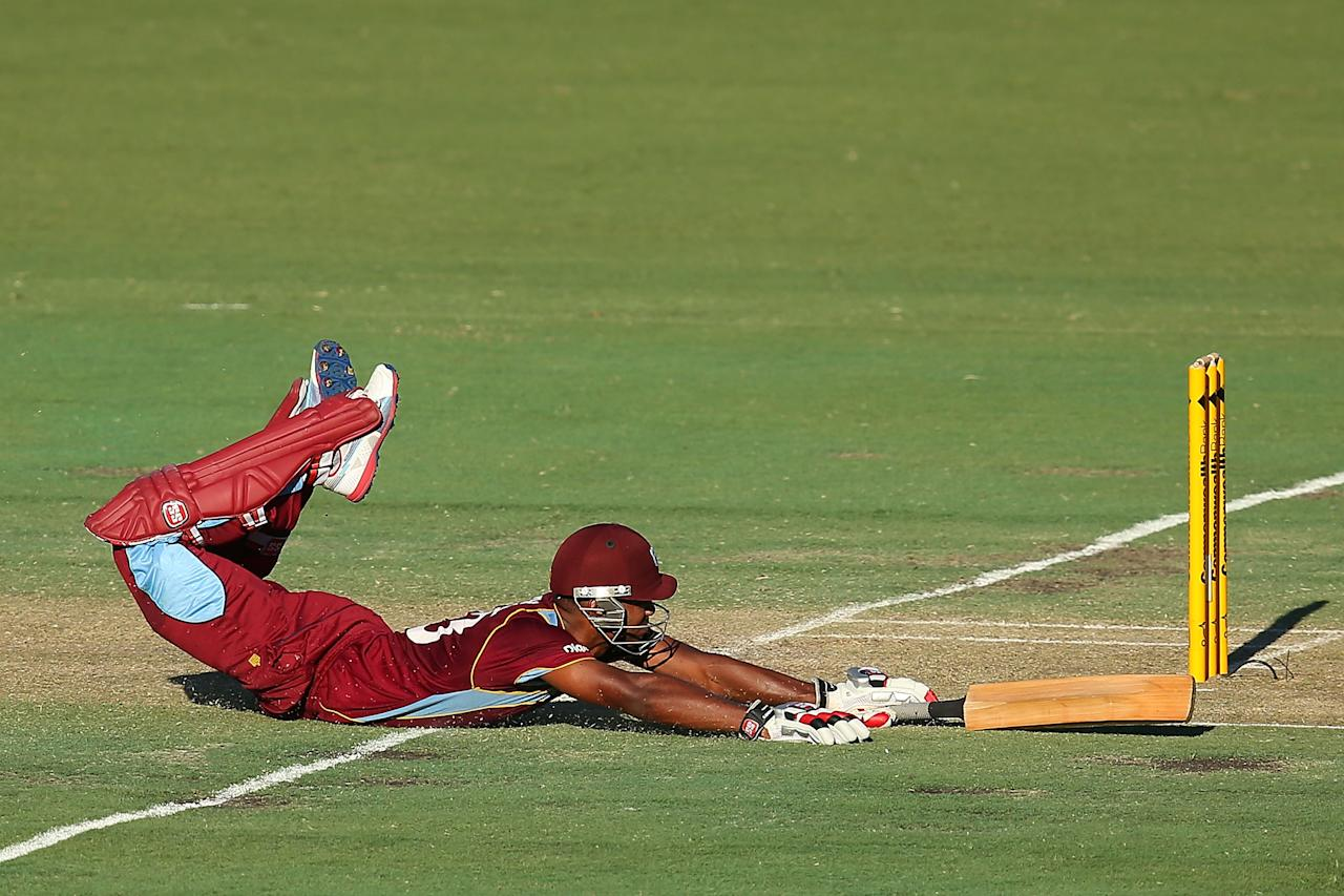 PERTH, AUSTRALIA - FEBRUARY 03:  Kieran Powell of the West Indies dives into the crease during game two of the Commonwealth Bank One Day International Series between Australia and the West Indies at WACA on February 3, 2013 in Perth, Australia.  (Photo by Paul Kane/Getty Images)