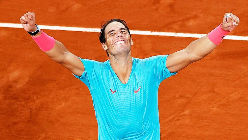 Rafa Nadal (pictured) throws his hands in the air as he celebrates winning the French Open.