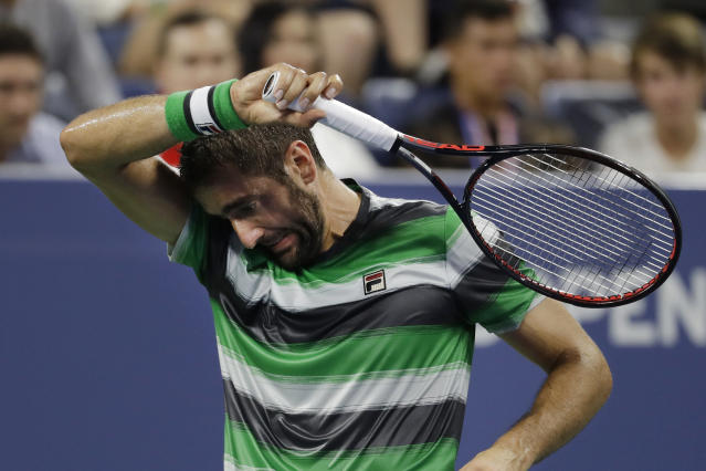 Marin Cilic, of Croatia, pauses during a third-round match against Alex de Minaur, of Australia, at the U.S. Open tennis tournament Saturday, Sept. 1, 2018, in New York. (AP Photo/Mark Lennihan)
