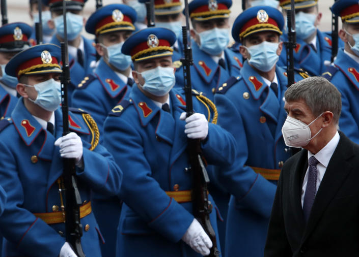Czech Prime Minister Andrej Babis, right, reviews the honor guard during a welcome ceremony ahead of meeting with his Serbian counterpart Ana Brnabic at the Serbia Palace in Belgrade, Serbia, Wednesday, Feb. 10, 2021. Babis is on a one-day official visit to Serbia. (AP Photo/Darko Vojinovic)